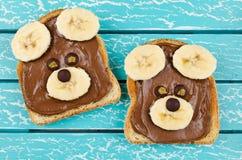 孩子点心的滑稽的熊面孔三明治 免版税库存图片