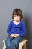 孩子生气的四岁的孩子的态度概念 免版税图库摄影