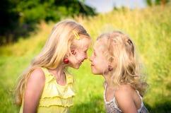 孩子用在面对面的耳朵的樱桃 库存照片