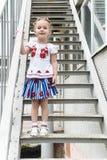 孩子画象一个老楼梯的 库存图片