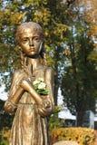 孩子的一个铜雕塑 库存图片