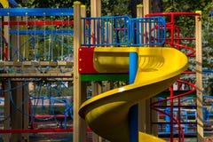 孩子的五颜六色的操场设备在公园 免版税图库摄影