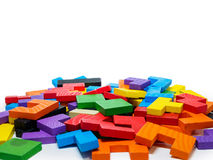 孩子的五颜六色的木难题在白色背景 库存照片