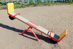 孩子的摇摆沙子的 免版税库存图片