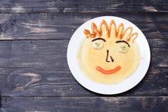 孩子的薄煎饼微笑 免版税图库摄影