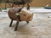 孩子的被手工造的木玩具猪 库存照片
