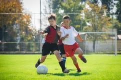 孩子的足球 免版税库存照片