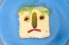 孩子的滑稽的三明治 库存照片