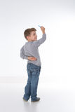 孩子看他的老师 免版税库存照片