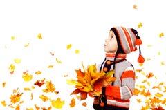 孩子秋天时尚,儿童男孩被编织的帽子夹克衣物 库存图片