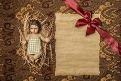 孩子耶稣和空白的老羊皮纸 Copyspace 库存图片