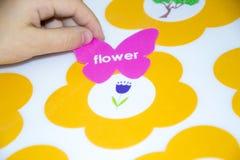 孩子胶合在补花的一个贴纸 图库摄影