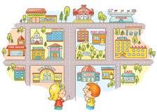 孩子问和告诉路对不同的城市大厦 免版税库存图片