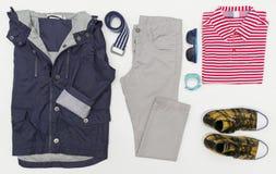 孩子顶视图时尚时髦神色穿衣 塑造孩子 春天,秋天成套装备 免版税库存照片