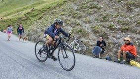 孩子骑自行车者 库存照片