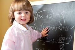 孩子画与在黑板的白垩 图库摄影