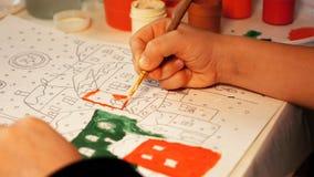 孩子绘与画笔的水彩画 免版税图库摄影