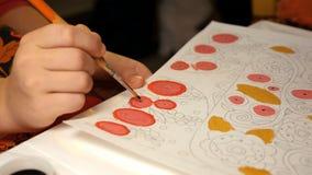 孩子绘与画笔的水彩画 免版税库存图片