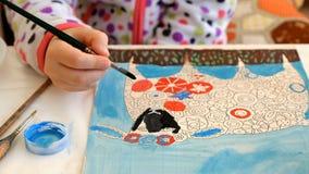 孩子绘与画笔的水彩画 图库摄影