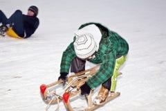 孩子滑冰在雪橇 免版税图库摄影
