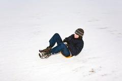 孩子滑冰在雪橇 库存照片