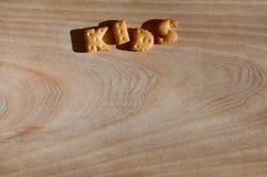 孩子 可食的信件堆  免版税图库摄影