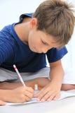 孩子画蜡笔 免版税库存图片