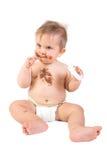 婴孩巧克力吃 免版税库存照片