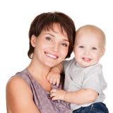 婴孩愉快母亲微笑 库存图片