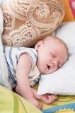 婴孩月亮休眠担任主角黄色 免版税库存照片