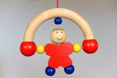 婴孩木玩具-辗压人 免版税库存照片