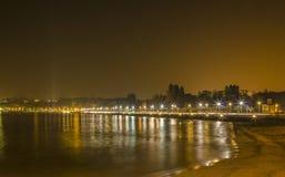 婴孩海滩日内瓦夜  库存图片