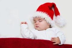 年轻婴孩照片圣诞老人帽子的 免版税图库摄影