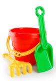 婴孩玩具桶和铁锹犁耙 免版税库存照片