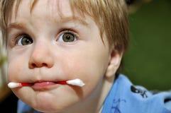 婴孩用在嘴的wadded棍子 库存照片