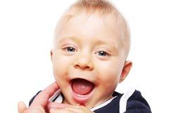 婴孩的第一颗牙-愉快的男孩 库存图片