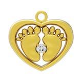 婴孩脚心脏与金刚石的gld垂饰 库存照片