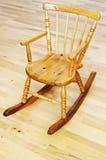 婴孩被雕刻的木摇椅 免版税库存照片