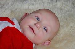 婴孩逗人喜爱位于 免版税库存照片