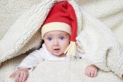 婴孩逗人喜爱的帽子圣诞老人 库存图片
