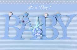 它男孩,蓝色题材婴孩旗布信件 库存图片
