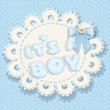 它` s与弓的一场男孩蓝色婴儿阵雨 免版税库存照片