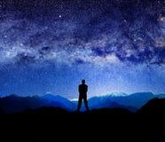 宇宙现出轮廓的人和光  库存图片