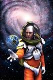 宇航员地球和星系 免版税图库摄影