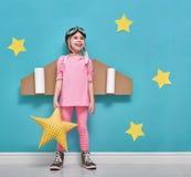 宇航员服装的女孩 图库摄影