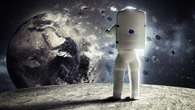 宇航员看从这ima月亮Elemen实验装置的地球  库存图片