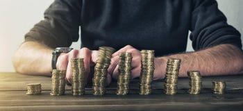 安全在彼此堆积的金钱欧洲货币硬币 免版税库存图片