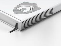 安全概念:闭合的书籍,在白色背景的盾 免版税图库摄影