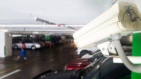 安全设备概念 特写镜头CCTV照相机监视在停车场 CCTV在汽车停车处安全保护系统的照相机监视 库存图片