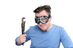 安全镜的人与一把生锈的可调扳手,隔绝在白色背景 汽车修理师概念 免版税库存照片